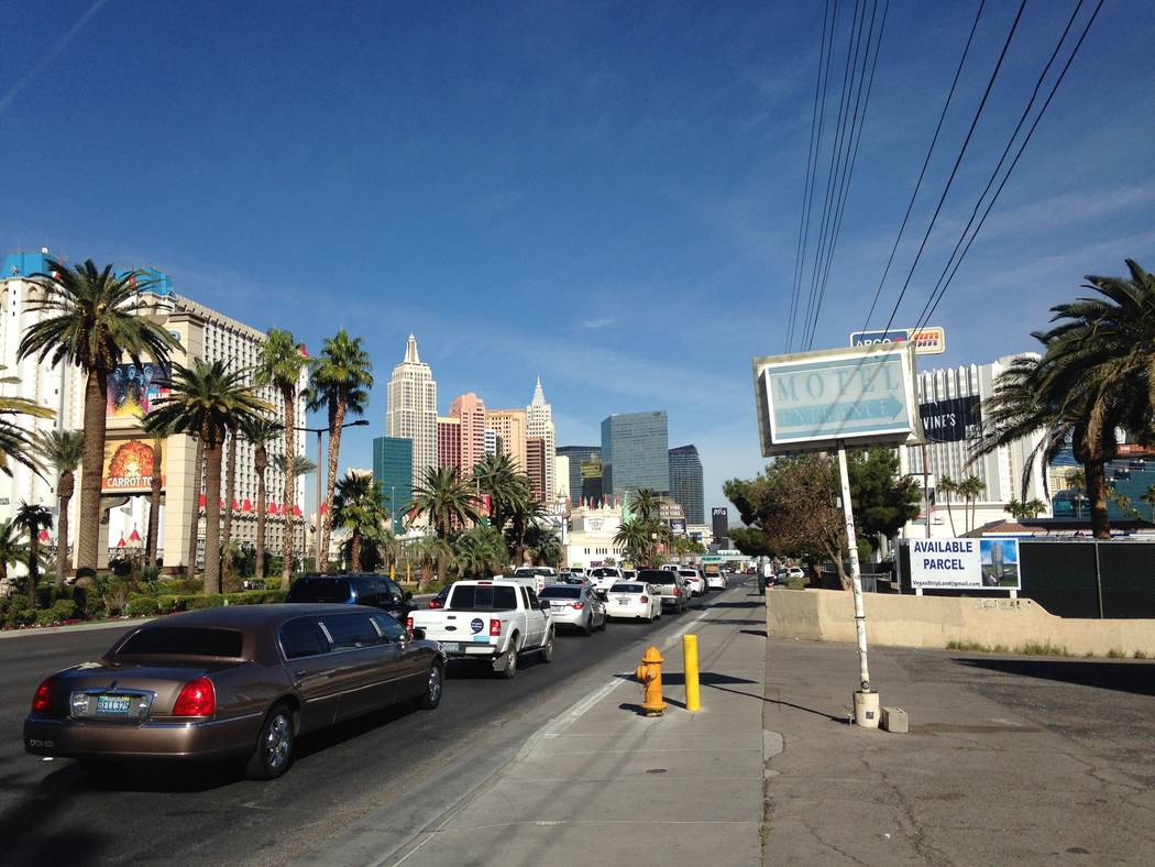 The sidewalk in front of Las Vegas Village, site of the Oct. 1 mass shooting, and the abandoned White Sands motel, which juts into the Village, is open to pedestrians on Friday, Nov. 10, 2017. Eli ...