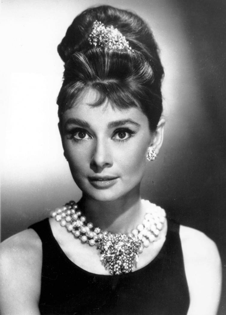 "In this undated file photo, actress Audrey Hepburn poses as Holly Golightly in the 1961 movie ""Breakfast at Tiffany's."" The New York-based jewelry retailer opened a restaurant at its flagship stor ..."