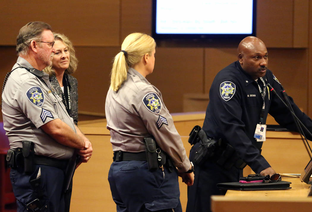 Las Vegas Department of Safety Deputy Chief, Michael Brown, right, speaks as Cynthia Leavitt, and Jim Rodger, left, both Animal Control supervisors, look on during the City Council meeting at Las  ...