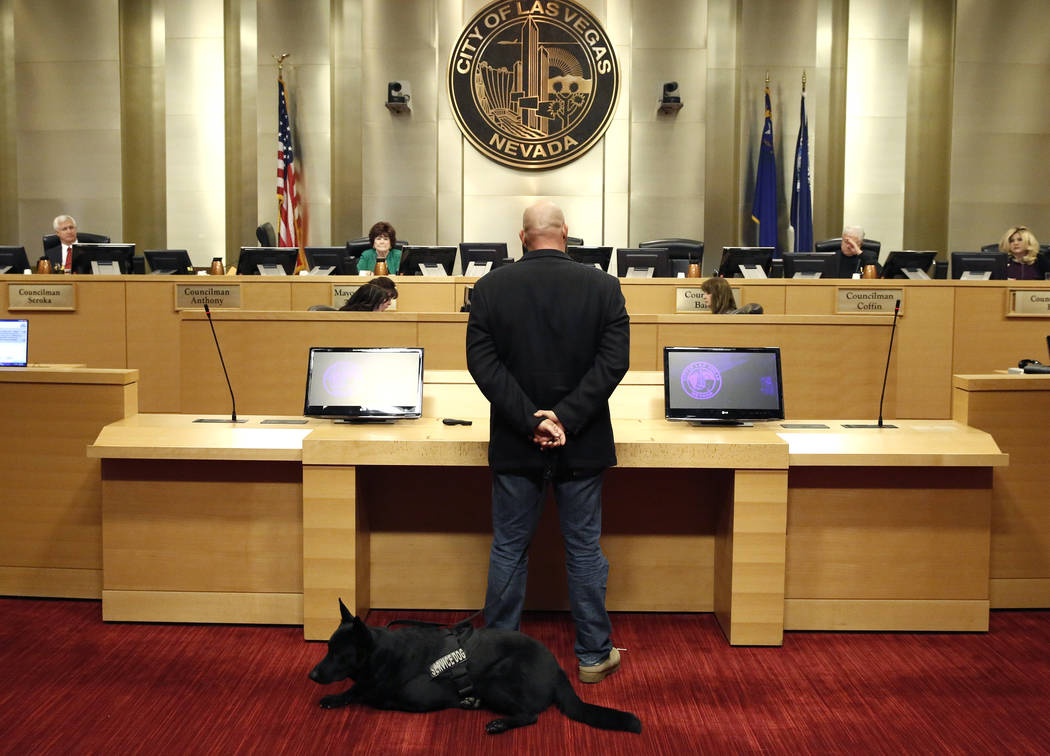 U.S. Army veteran Michael Neil, accompanied by his service dog Yamas, speaks during the City Council meeting at Las Vegas City Hall Wednesday, Nov. 15, 2017. Neil supports the repeal of a ban that ...