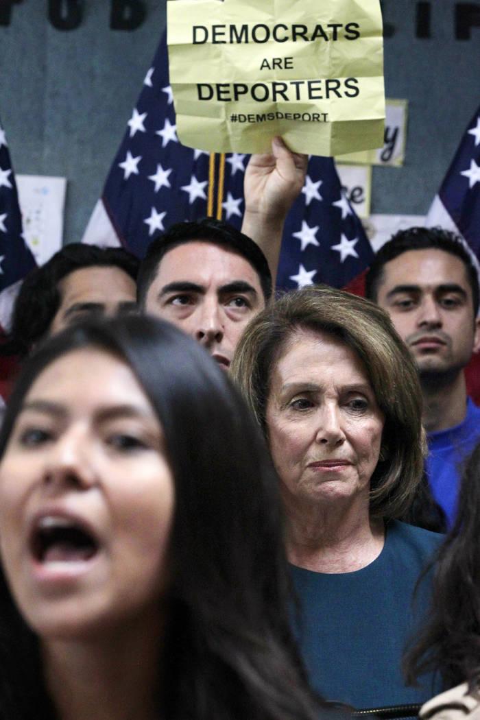 U.S. Rep. Nancy Pelosi, D-Calif., waits as protesters yell during a press conference on the Deferred Action for Childhood Arrivals, or DACA program, on Monday, Sept. 18, 2017 in San Francisco. Sev ...