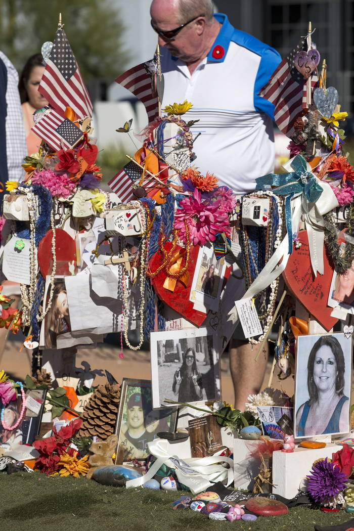 The crosses and mementos left behind by visitors at a memorial for Route 91 Harvest shooting victims at the Welcome to Fabulous Las Vegas sign, Thursday, Nov. 9, 2017. Richard Brian Las Vegas Revi ...