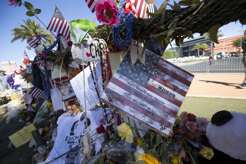 The cross of Chris Hazencomb, 44, of Camarillo, California at a memorial for Route 91 Harvest shooting victims at the Welcome to Fabulous Las Vegas sign, Sunday, Oct. 15, 2017. Richard Brian Las V ...
