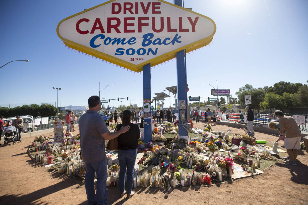 People visit a memorial for Route 91 Harvest shooting victims at the Welcome to Fabulous Las Vegas sign, Sunday, Oct. 15, 2017. Richard Brian Las Vegas Review-Journal @vegasphotograph