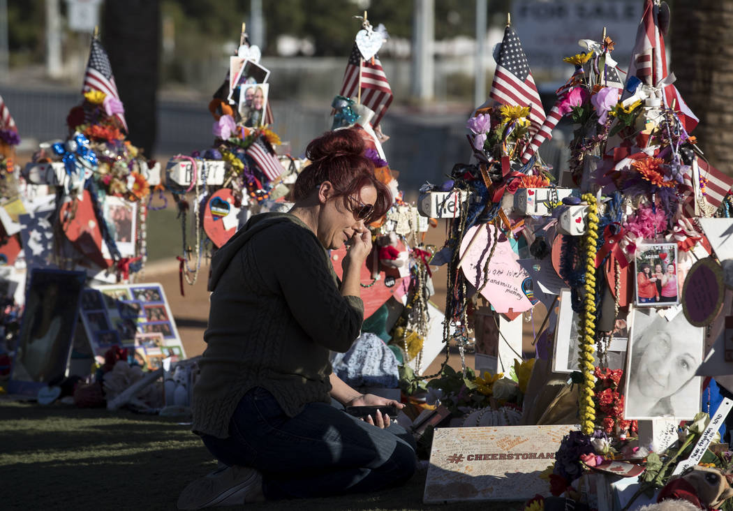 Jessica Traux of Beaumont, California, visits the cross of her friend and neighbor, Hannah Ahlers, a 35-year-old mother of three, at a memorial for victims of the Route 91 Harvest shooting at the  ...