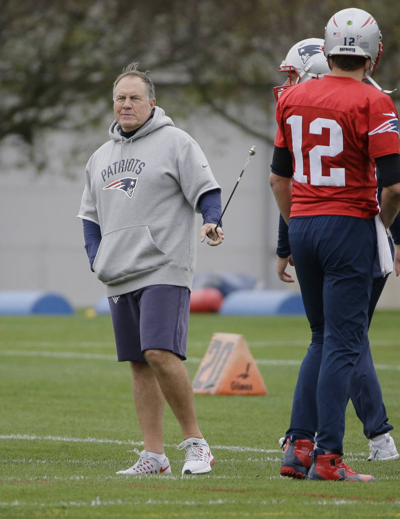 New England Patriots head coach Bill Belichick, left, walks on the field near quarterback Tom Brady (12) during an NFL football practice, Wednesday, Nov. 1, 2017, in Foxborough, Mass. The Patriots ...