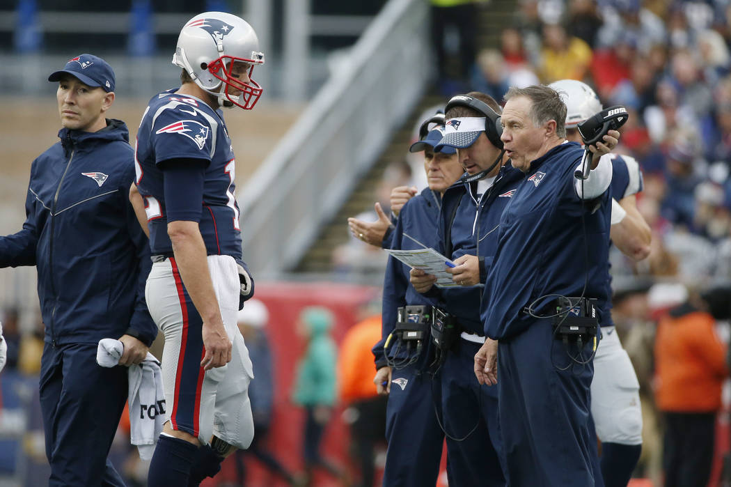 New England Patriots coach Bill Belichick, right, instructs New England Patriots quarterback Tom Brady, left, during the second half of an NFL football game against the Los Angeles Chargers, Sunda ...