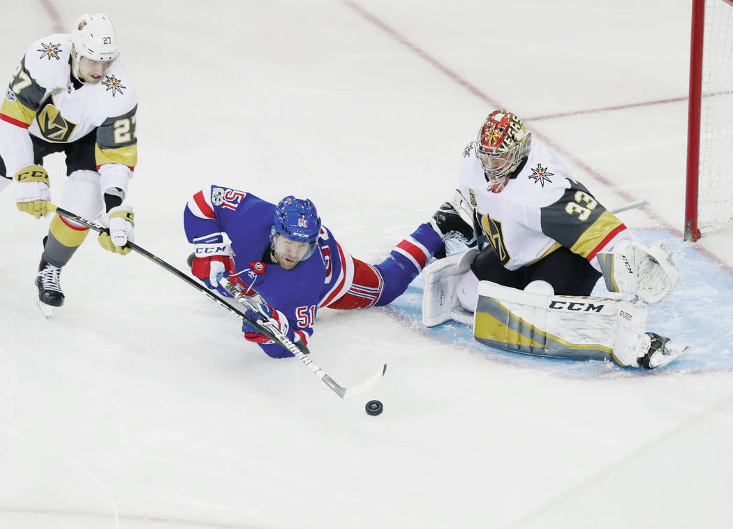 Vegas Golden Knights defenseman Shea Theodore (27) and goalie Maxime Lagace (33) defend against New York Rangers' David Desharnais (51) during the third period of an NHL hockey game Tuesday, Oct.  ...