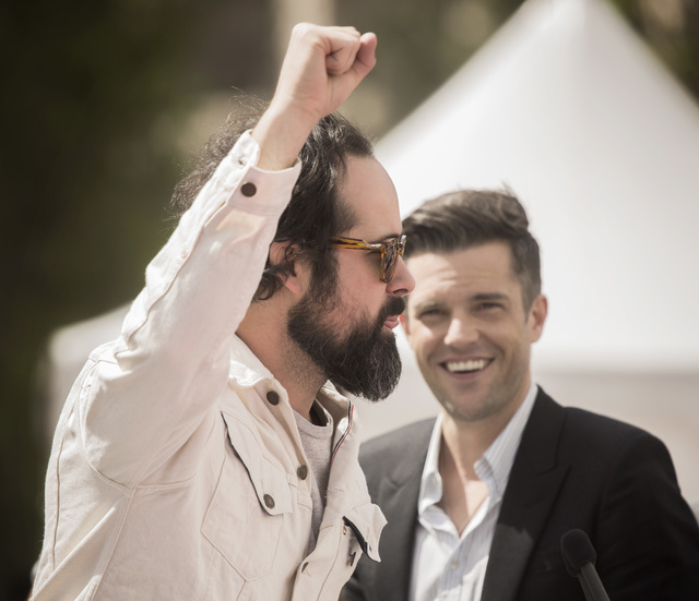 The Killers band members Ronnie Vannucci, left, raises his hand as lead singer Brandon Flowers looks on during a press conference at Toshiba Plaza on Wednesday, April 6, 2016. Jeff Scheid/Las Vega ...