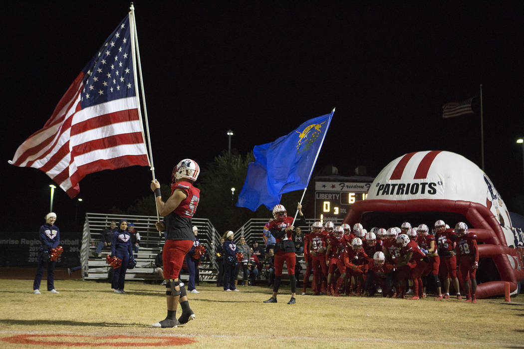 Liberty players prepare to take to the field prior to the start of the class 4A Sunrise Region title game against Green Valley at Liberty High School Friday, Nov. 17, 2017, in Henderson. (Bridget  ...