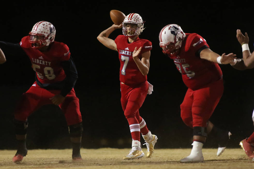 Liberty player A.J. Barilla (7) passes the ball during the class 4A Sunrise Region title game against Green Valley at Liberty High School Friday, Nov. 17, 2017, in Henderson. (Bridget Bennett/Las  ...