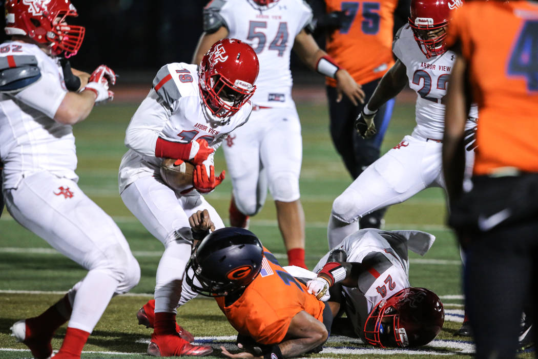 Arbor View's Darius Harrison (19), second from left, catches the ball after Bishop Gorman's Dorian Thompson-Robinson (14), center, was tackled during the first quarter of the Class 4A Sunset Regio ...