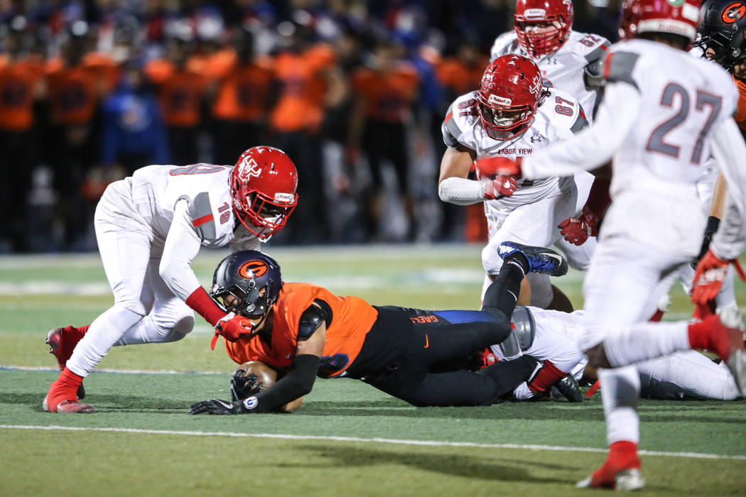 Arbor View's Darius Harrison (19), left, tackles Bishop Gorman's Amod Cianelli (28), right, during the second quarter of the Class 4A Sunset Region Title football game at Bishop Gorman High School ...