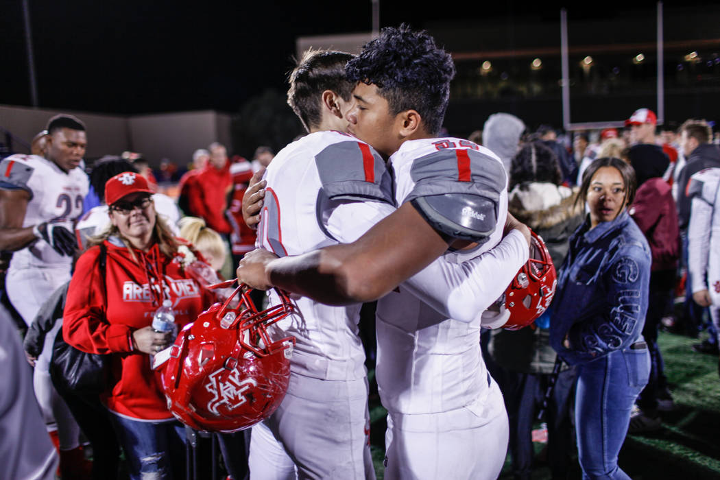 Arbor View's Logan Bollinger (10), left, comforts Tai Tuinei (54), right, after losing to Bishop Gorman 42-7 in the Class 4A Sunset Region Title football game at Bishop Gorman High School in Las V ...