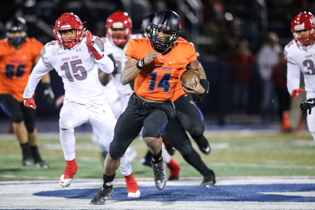 Bishop Gorman's Dorian Thompson-Robinson (14) runs the ball against Arbor View during the fourth quarter of the Class 4A Sunset Region Title football game at Bishop Gorman High School in Las Vegas ...