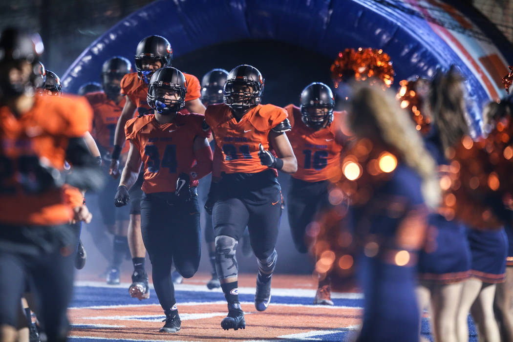 Bishop Gorman runs onto the field before the start of the Class 4A Sunset Region Title football game against Arbor View at Bishop Gorman High School in Las Vegas, Friday, Nov. 17, 2017. Bishop Gor ...