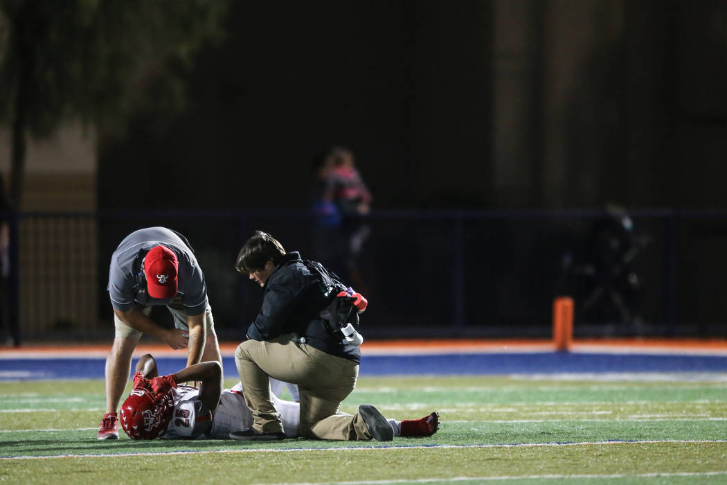 Arbor View's Kyle Graham-Robinson (25) lies on the field after an injury during the second quarter of the Class 4A Sunset Region Title football game against Bishop Gorman at Bishop Gorman High Sch ...