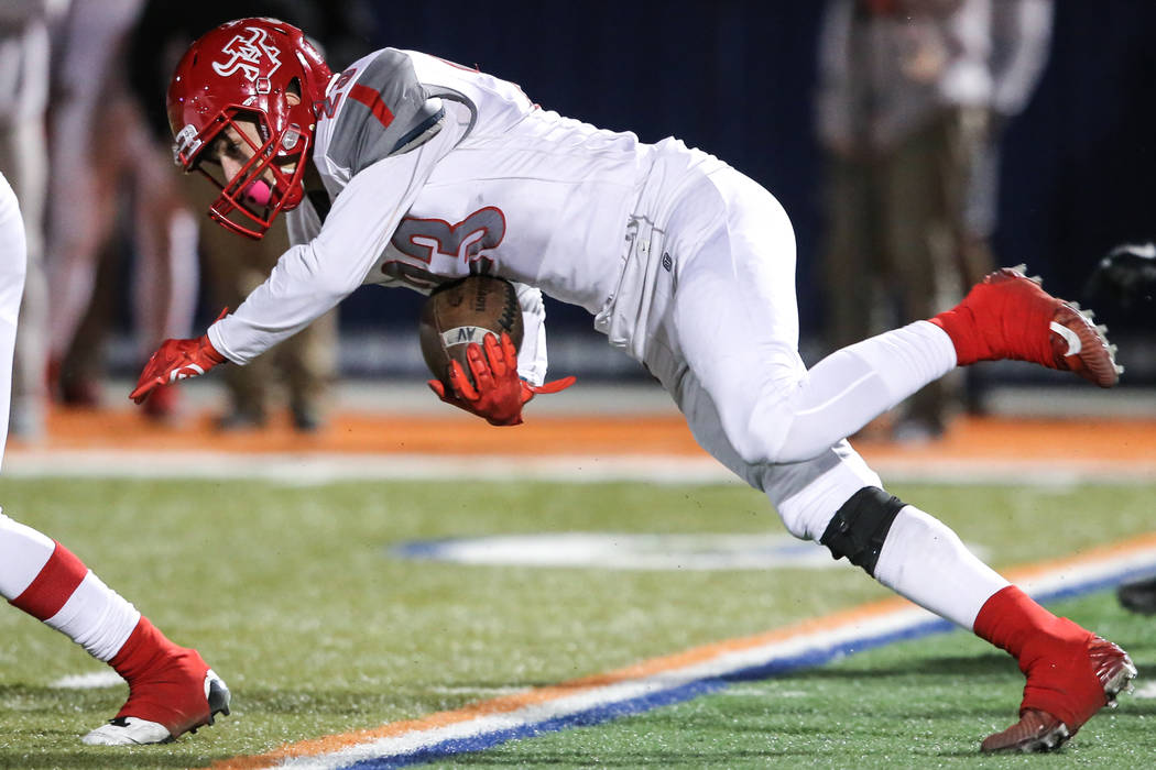 Arbor View's Deago Stubbs (23) runs the ball against Bishop Gorman during the second quarter of the Class 4A Sunset Region Title football game at Bishop Gorman High School in Las Vegas, Friday, No ...