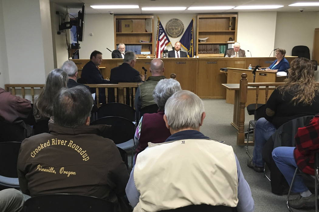 The Crook County commissioners hold a public meeting on Wednesday, Nov. 8, 2017, in Prineville, Ore. (AP Photo/Andrew Selsky)