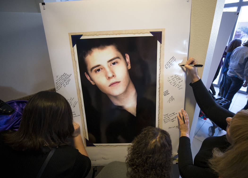 Guests sign a poster of Cameron Robinson during a celebration of life for Robinson at Las Vegas City Hall on Thursday, Oct. 26, 2017. Richard Brian Las Vegas Review-Journal @vegasphotograph