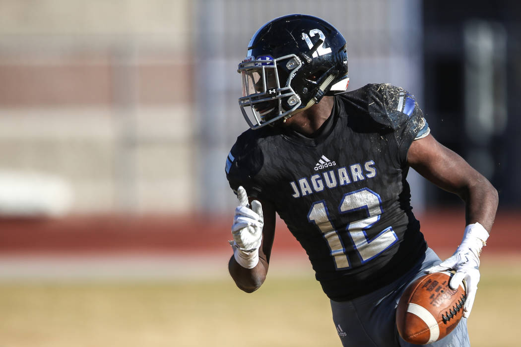 Desert Pines' Jyden King (12) scores a touchdown against Spring Creek during the second quarter of the Class 3A State football game at Desert Pines High School in Las Vegas, Saturday, Nov. 18, 201 ...