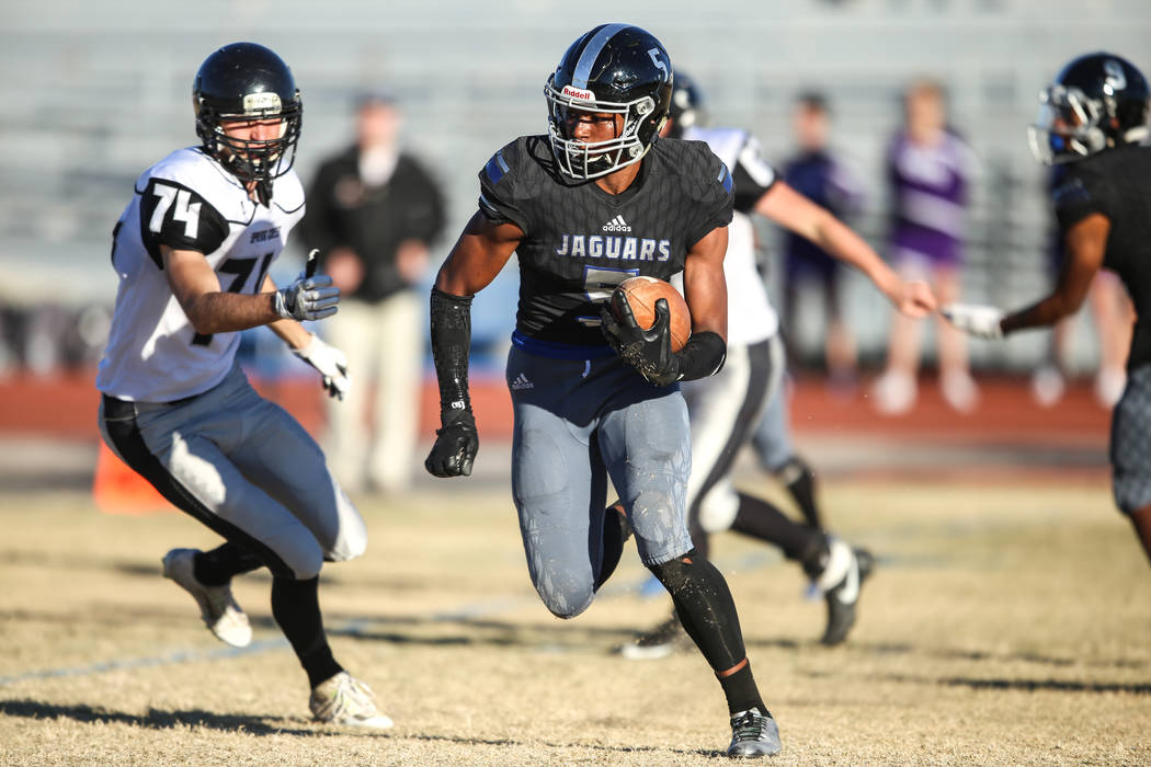 Desert Pines' Jordan Howden (5) runs the ball against Spring Creek during the fourth quarter of the Class 3A State football game at Desert Pines High School in Las Vegas, Saturday, Nov. 18, 2017.  ...