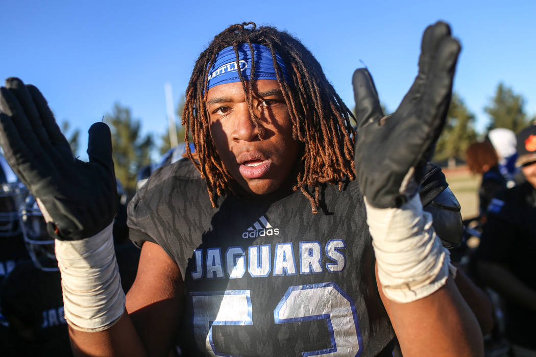 Desert Pines' Lorenzo Sheldon Brown (53) celebrates after defeating Spring Creek 50-28 in the end of the Class 3A State football game at Desert Pines High School in Las Vegas, Saturday, Nov. 18, 2 ...