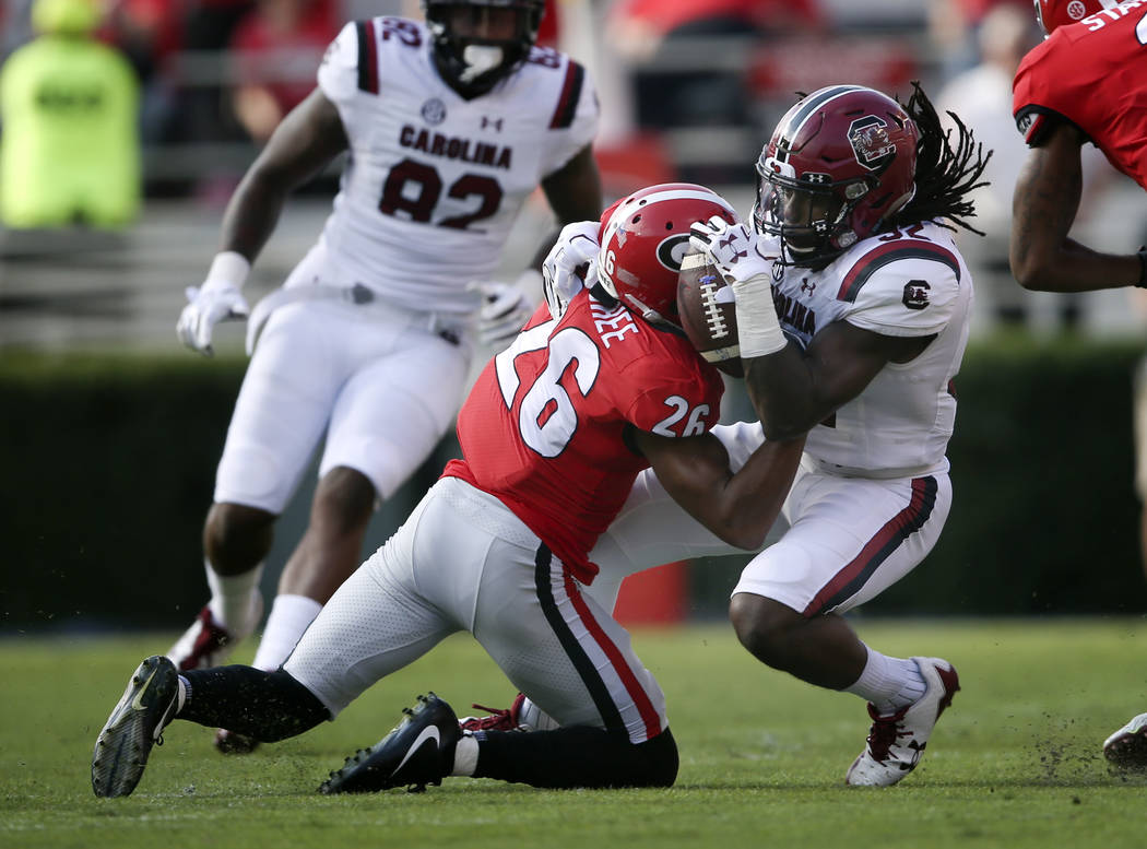 South Carolina's Caleb Kinlaw (32) recovers an on side kick against Georgia's Tyrique McGhee (26) on the opening kick off during the first half of an NCAA college football game Saturday, Nov. 4, 2 ...