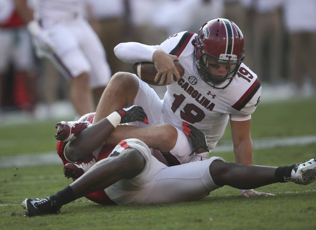 South Carolina quarterback Jake Bentley (19) is sacked by Georgia linebacker Roquan Smith (3) during the first half of an NCAA college football game Saturday, Nov. 4, 2017, in Athens, Ga. (AP Phot ...