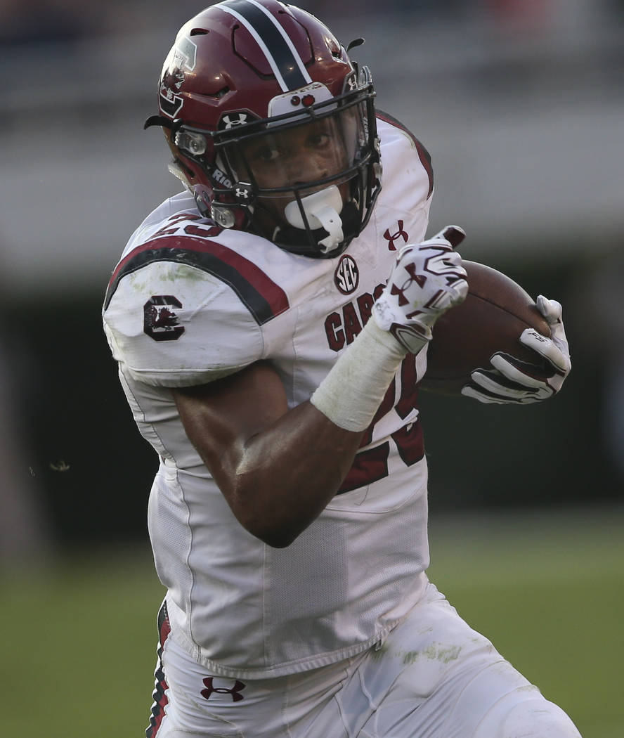 South Carolina running back A.J. Turner (25) runs against Georgia during the second half of an NCAA college football game Saturday, Nov. 4, 2017, in Athens, Ga. Georgia won 24-10. (AP Photo/John B ...