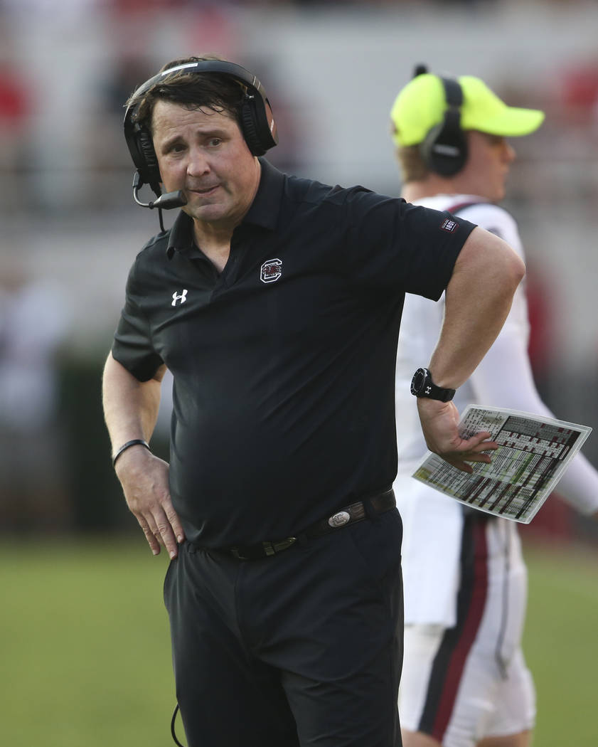 South Carolina head coach Will Muschamp looks on from the sideline during the second half of an NCAA college football game against Georgia Saturday, Nov. 4, 2017, in Athens, Ga. Georgia won 24-10. ...