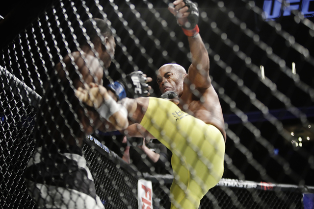 Anderson Silva, right, of Brazil, kicks Derek Brunson during a middleweight mixed martial arts bout at UFC 208 early Sunday, Feb. 12, 2017, in New York. Silva won the fight. (AP Photo/Frank Frankl ...