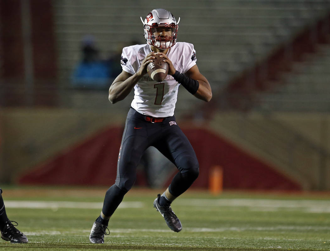UNLV quarterback Armani Rogers runs for yardage during the first half of an NCAA college football game against New Mexico in Albuquerque, N.M., Friday, Nov. 17, 2017. (AP Photo/Andres Leighton)