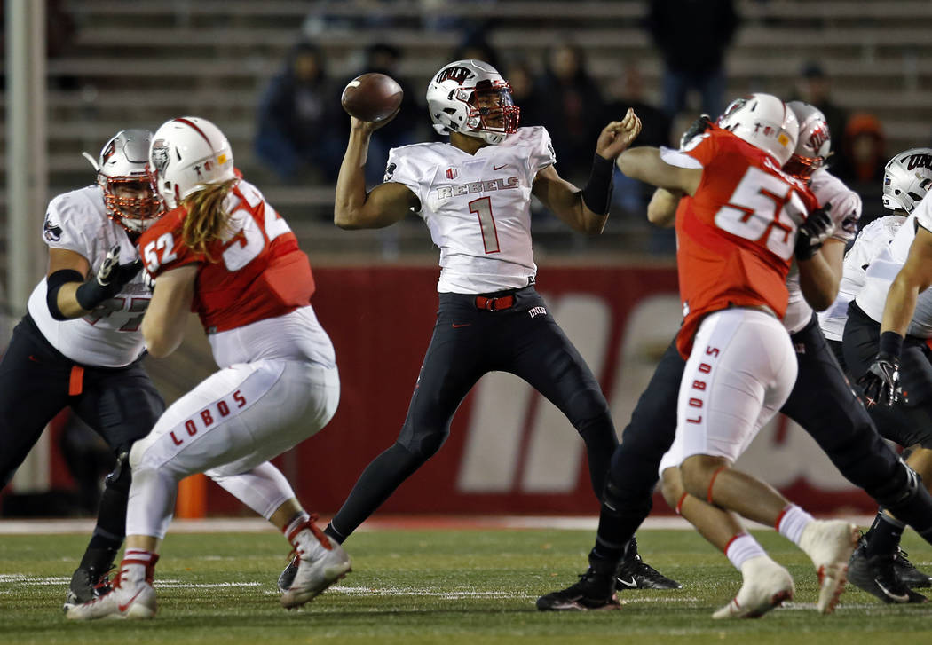 UNLV quarterback Armani Rogers (1) throws against New Mexico during the second half of an NCAA college football game in Albuquerque, N.M., Friday, Nov. 17, 2017. UNLV won 38-35. (AP Photo/Andres L ...