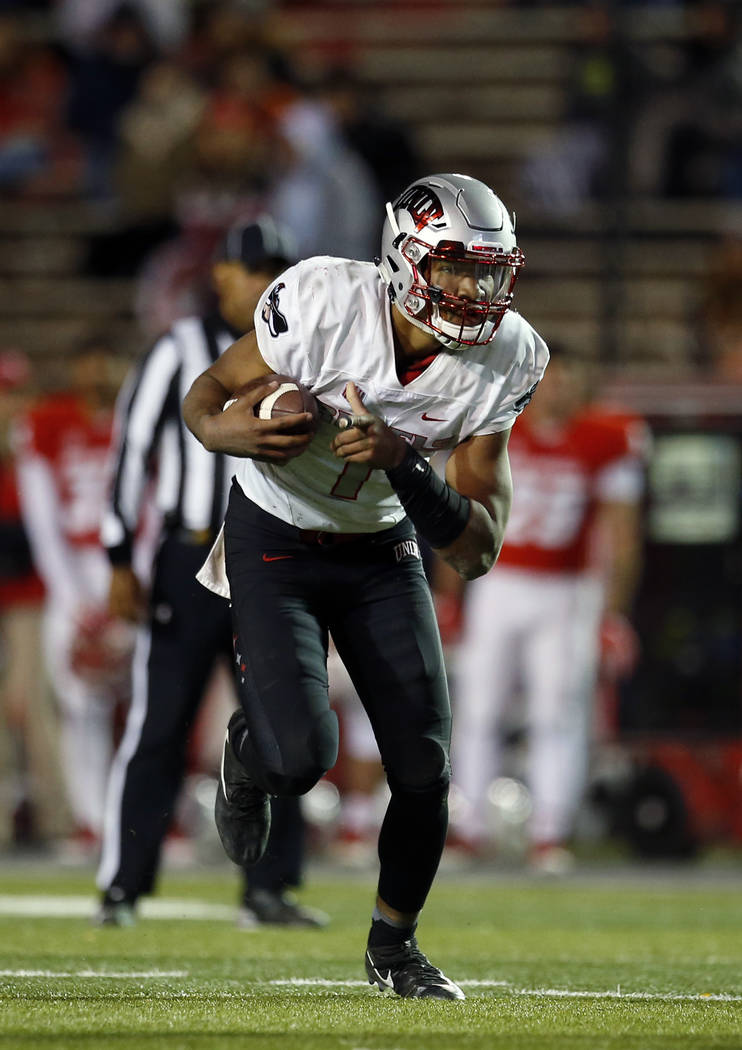 UNLV quarterback Armani Rogers runs for yardage during the second half of an NCAA college football game against New Mexico in Albuquerque, N.M., Friday, Nov. 17, 2017. (AP Photo/Andres Leighton)