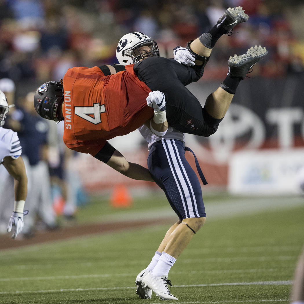 Brigham Young Cougars defensive back Micah Hannemann (7) tackles UNLV Rebels quarterback Johnny Stanton (4) in the football game at Sam Boyd Stadium in Las Vegas, Friday, Nov. 10, 2017. Erik Verdu ...
