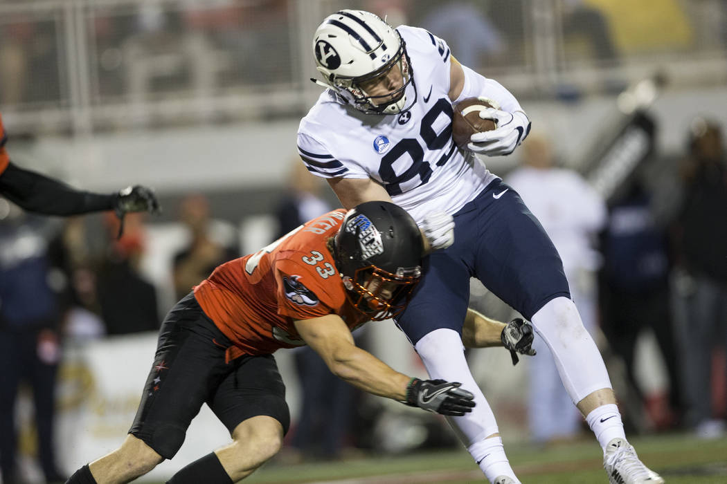 Brigham Young Cougars tight end Matt Bushman (89) runs the ball against UNLV Rebels defensive back Dalton Baker (33) in the football game at Sam Boyd Stadium in Las Vegas, Friday, Nov. 10, 2017. E ...
