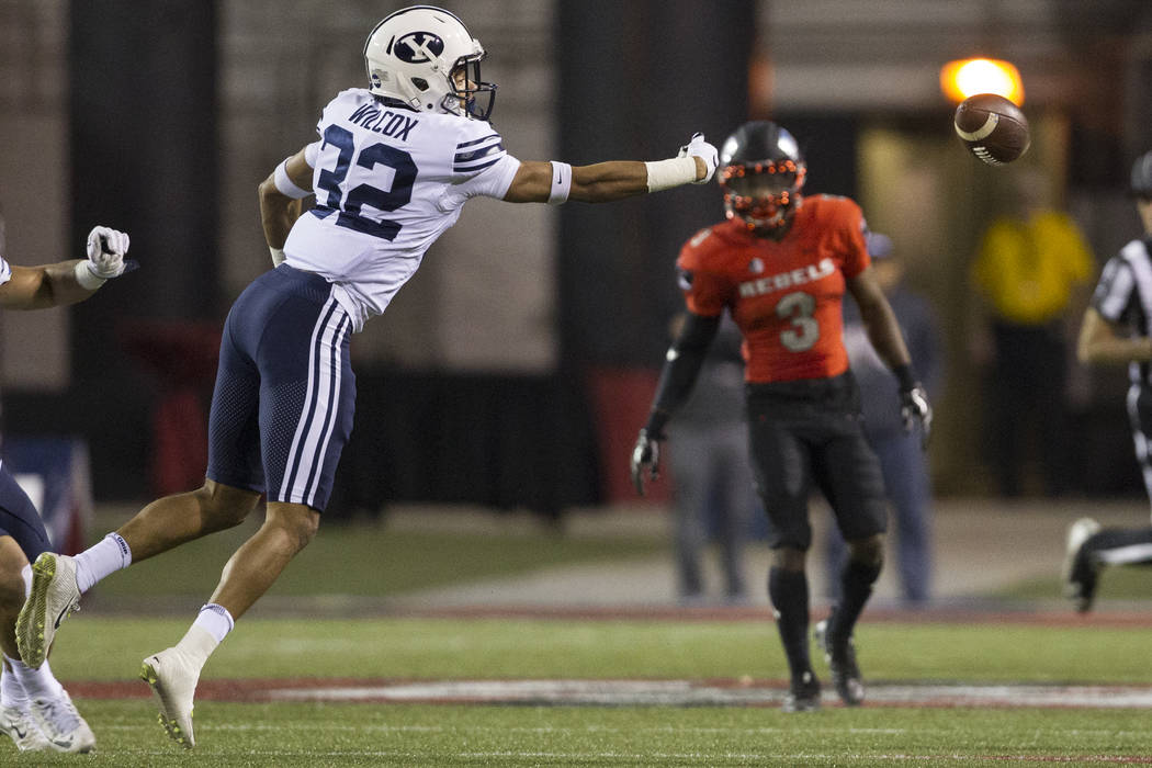 Brigham Young Cougars defensive back Chris Wilcox (32) is short for an interception against UNLV Rebels in the football game at Sam Boyd Stadium in Las Vegas, Friday, Nov. 10, 2017. Erik Verduzco  ...