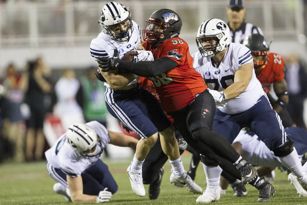 UNLV Rebels defensive lineman Nick Dehdashtian (98) tackles Brigham Young Cougars running back Austin Kafentzis (2) in the football game at Sam Boyd Stadium in Las Vegas, Friday, Nov. 10, 2017. Er ...