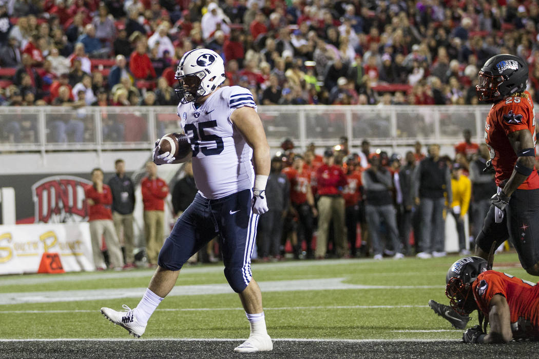 Brigham Young Cougars running back Brayden El-Bakri (35) runs for a touchdown against UNLV Rebels in the football game at Sam Boyd Stadium in Las Vegas, Friday, Nov. 10, 2017. Erik Verduzco Las Ve ...