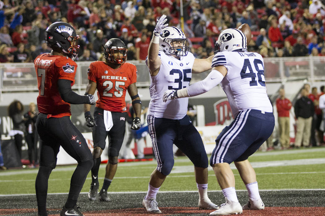 Brigham Young Cougars running back Brayden El-Bakri (35) celebrates his touchdown against UNLV Rebels in the football game at Sam Boyd Stadium in Las Vegas, Friday, Nov. 10, 2017. Erik Verduzco La ...