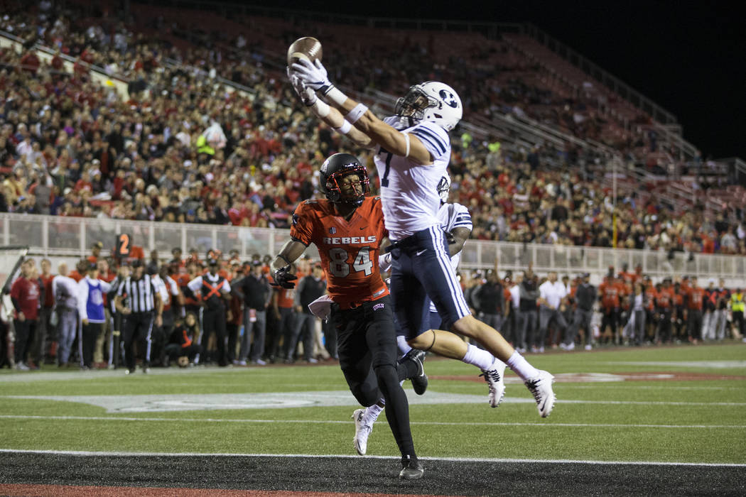 Brigham Young Cougars defensive back Micah Hannemann (7) is short for an interception against UNLV Rebels wide receiver Kendal Keys (84) in the football game at Sam Boyd Stadium in Las Vegas, Frid ...