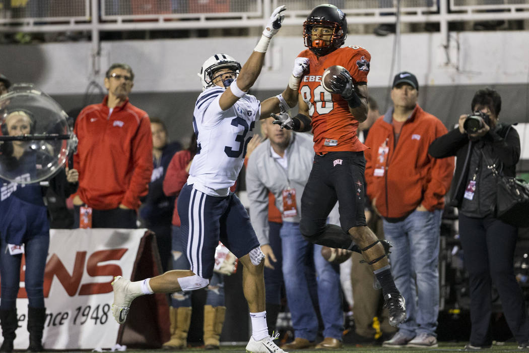 UNLV Rebels wide receiver Brandon Presley (80) makes a catch against Brigham Young Cougars defensive back Chris Wilcox (32) in the football game at Sam Boyd Stadium in Las Vegas, Friday, Nov. 10,  ...