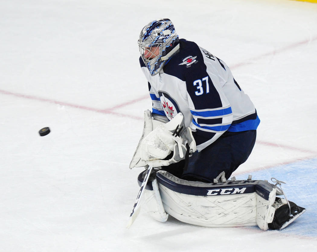 Winnipeg Jets goalie Connor Hellebuyck makes a chest save against the Vegas Golden Knights in the second period of their NHL hockey game at T-Mobile Arena in Las Vegas Friday November 10, 2017. Jo ...