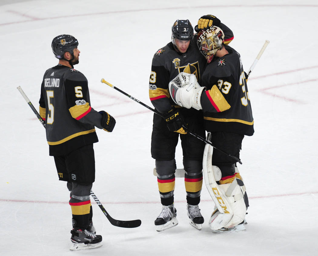 Vegas Golden Knights defenseman Brayden McNabb (3) embraces goalie Maxime Lagace in the third period of their NHL hockey game against the Winnipeg Jets at T-Mobile Arena in Las Vegas Friday Novemb ...