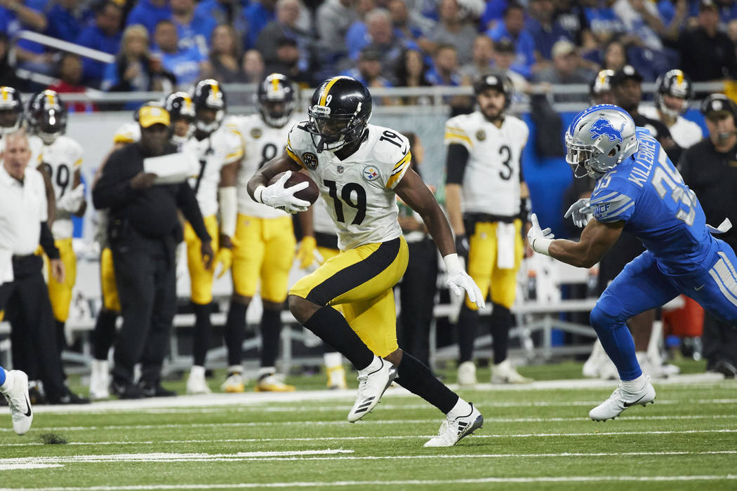 Pittsburgh Steelers wide receiver JuJu Smith-Schuster (19) runs the ball against the Detroit Lions during an NFL football game Sunday, Oct. 29, 2017, in Detroit. (AP Photo/Rick Osentoski)
