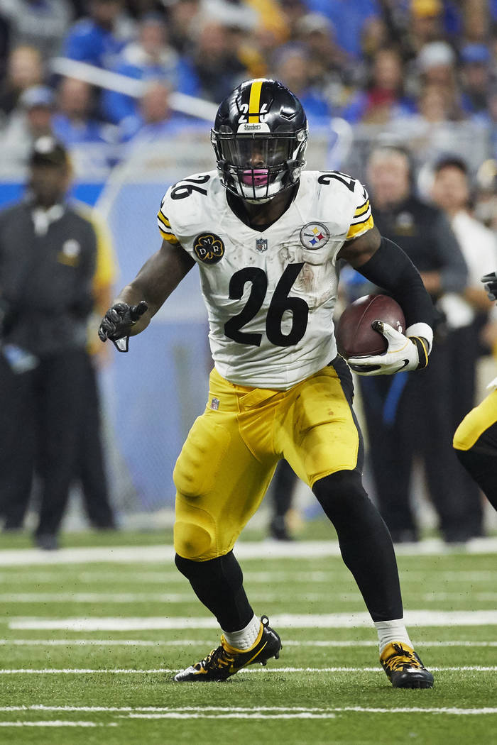 Pittsburgh Steelers running back Le'Veon Bell (26) rushes against the Detroit Lions during an NFL football game Sunday, Oct. 29, 2017, in Detroit. (AP Photo/Rick Osentoski)