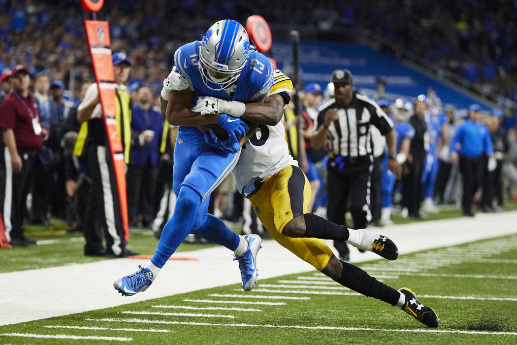 Detroit Lions wide receiver T.J. Jones (13) is tackled by Pittsburgh Steelers strong safety Sean Davis (28) during an NFL football game Sunday, Oct. 29, 2017, in Detroit. (AP Photo/Rick Osentoski)