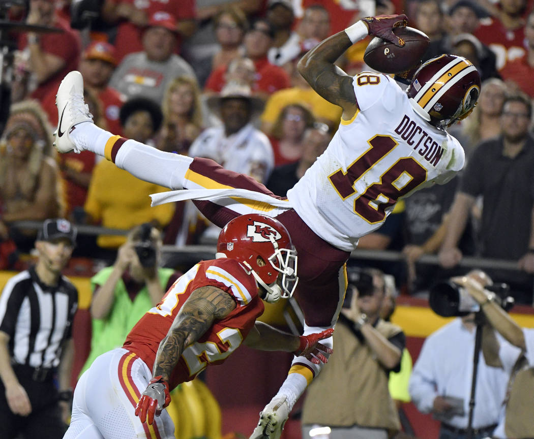 Washington Redskins wide receiver Josh Doctson (18) can't hold on to a pass in the end zone against Kansas City Chiefs defensive back Phillip Gaines (23) during the second half of an NFL football  ...