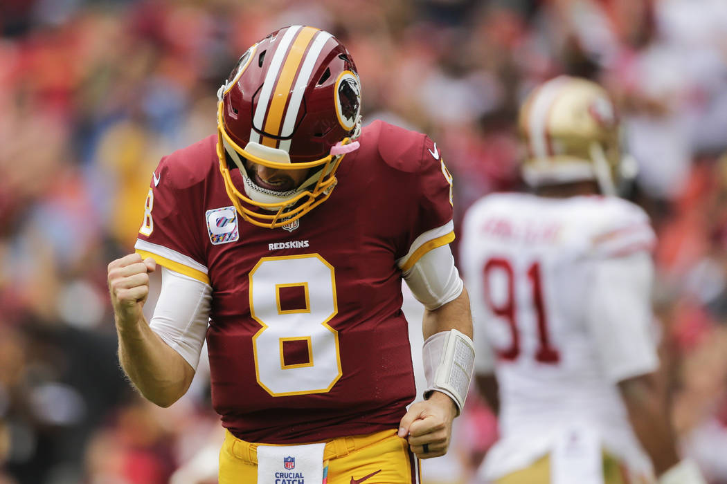 Washington Redskins quarterback Kirk Cousins (8) celebrates wide receiver Josh Doctson's touchdown during the first half of an NFL football game against the San Francisco 49ers in Landover, Md., S ...